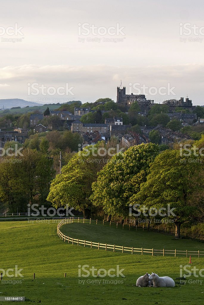 Lancaster castle, in front of green fields and sheep royalty-free stock photo