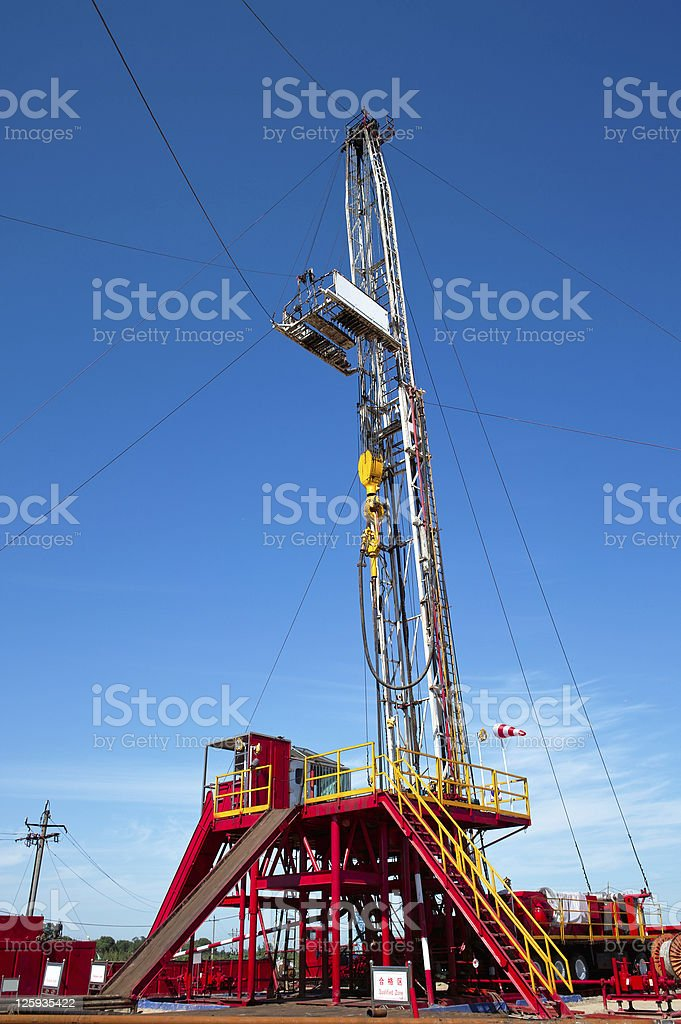 Land drilling rig against the blue sky royalty-free stock photo