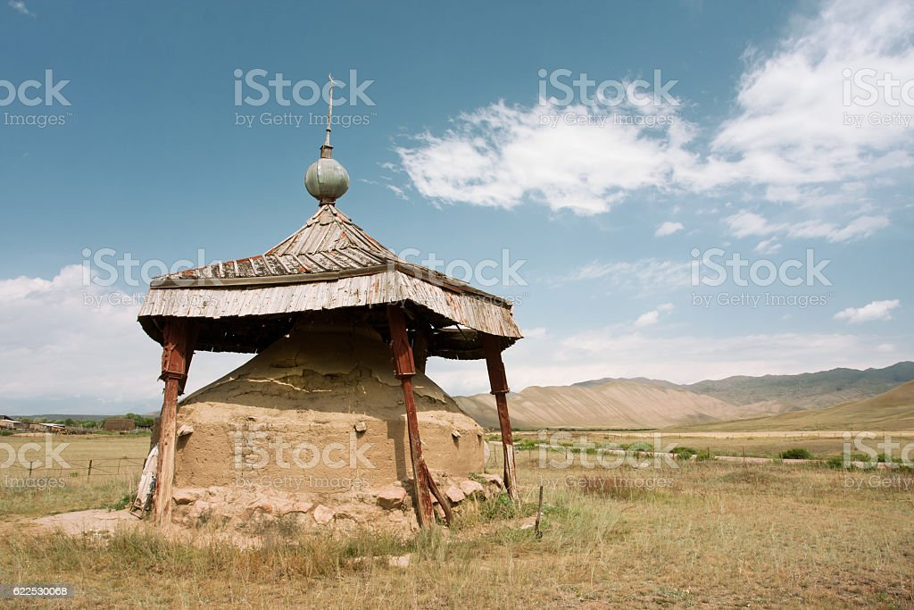Land embankment installed as monument in valley, Kyrgyzstan. stock photo