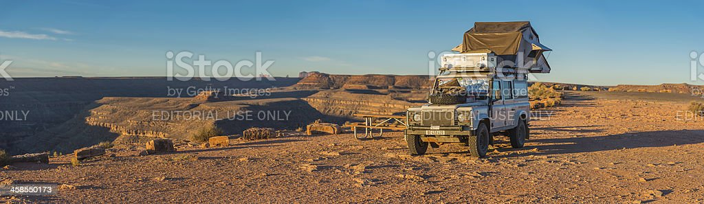 Land Rover camping in Monument Valley sunrise panorama Utah USA stock photo