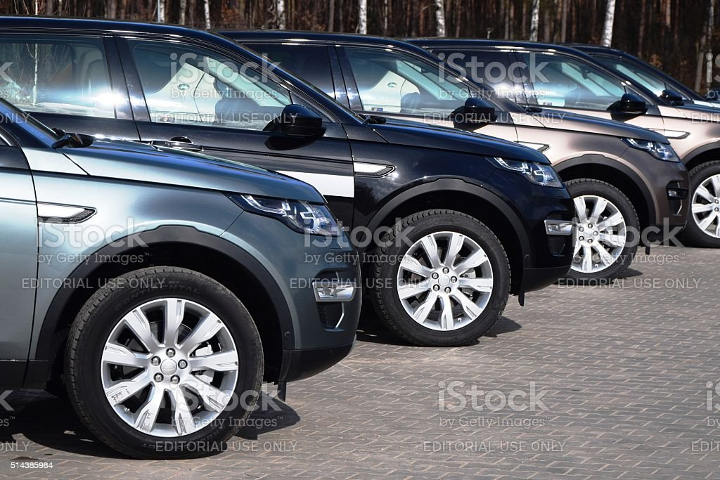 Land Rover cars in a row stock photo