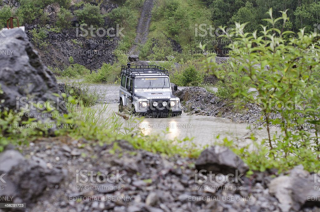Land Rover Defender in all-terrain stock photo