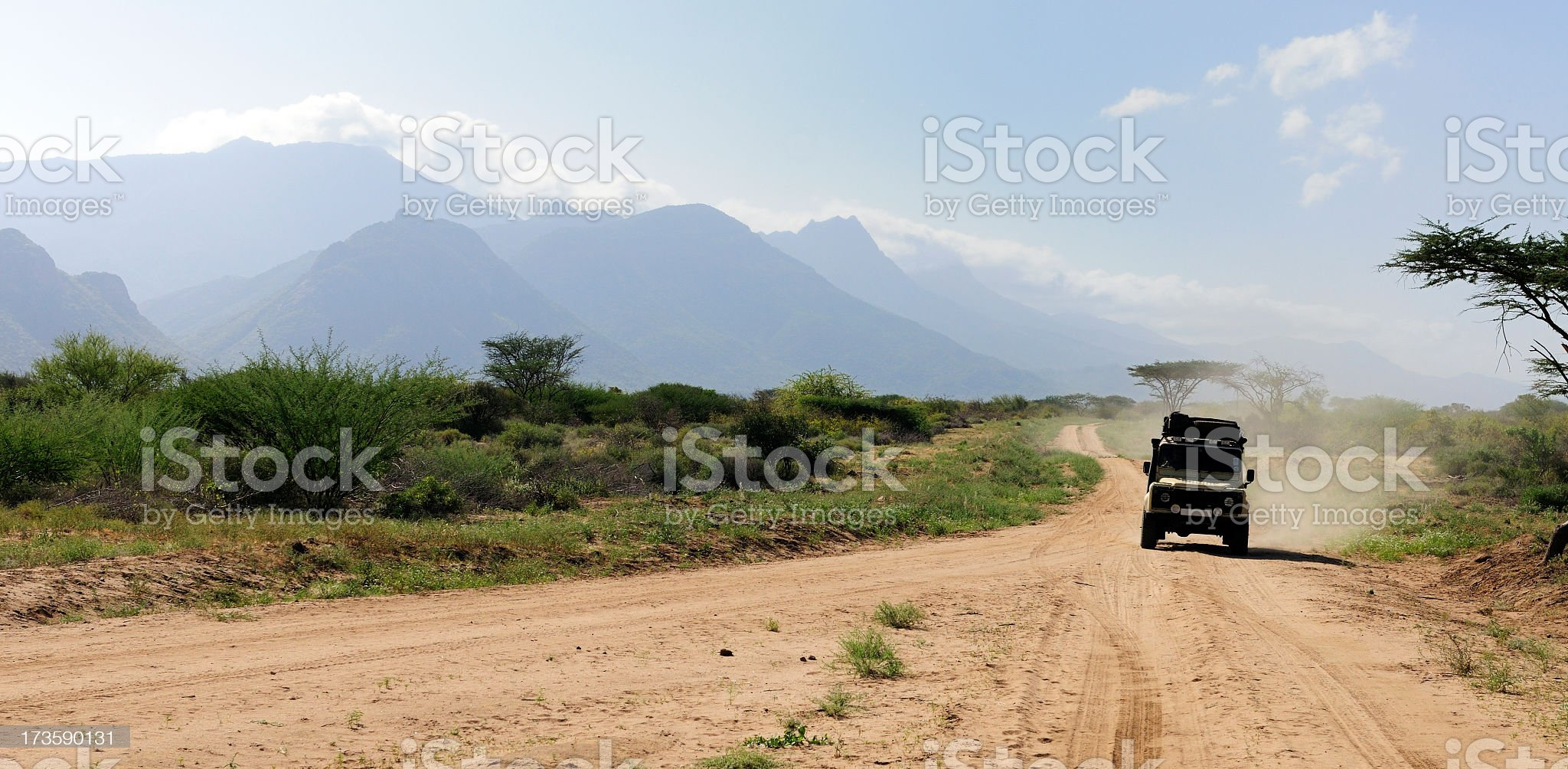 A land rover in the wild in the African adventure royalty-free stock photo