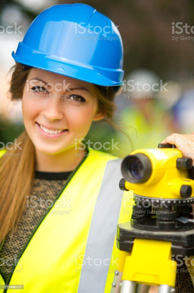 female land surveyor smiling at camera