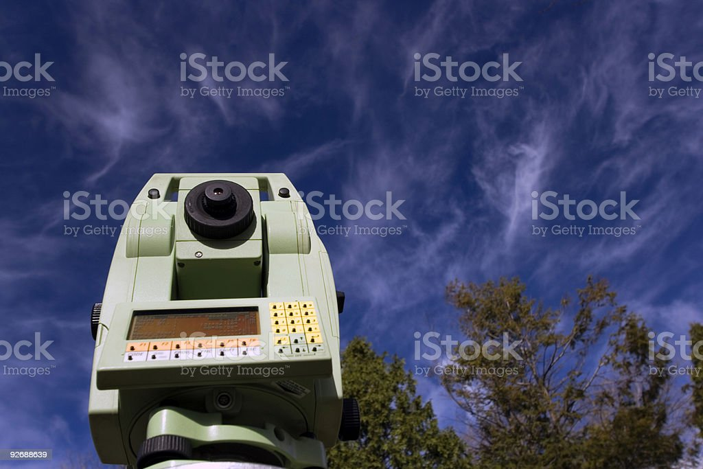 Land Surveying Under Cloudy Sky royalty-free stock photo