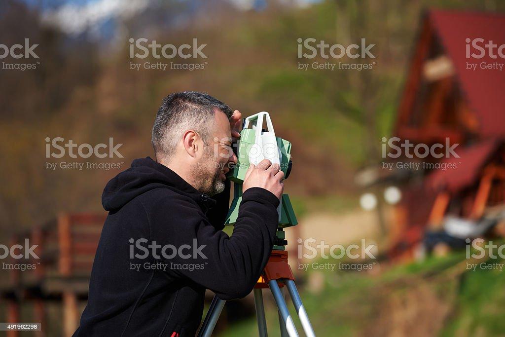 land surveyor calculating stock photo