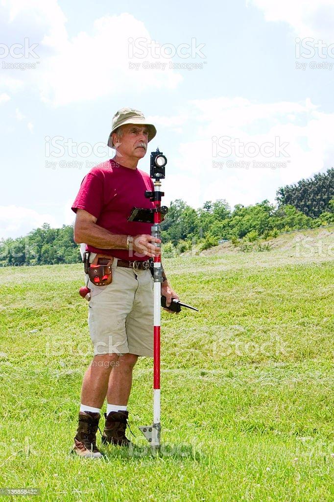 Land Surveyor in Grass royalty-free stock photo