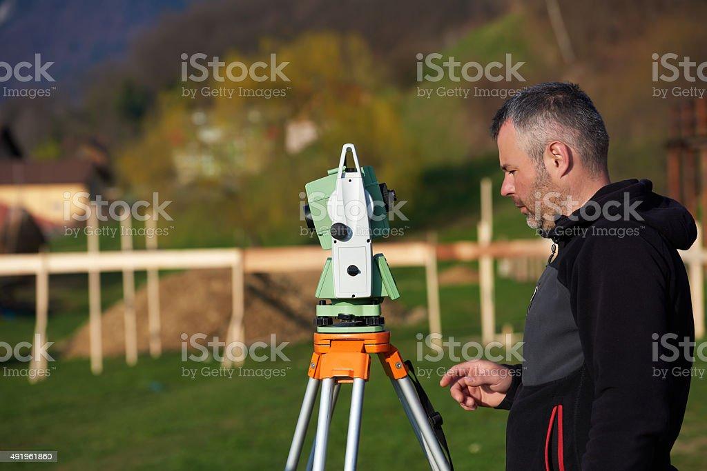 land surveyor take measures stock photo