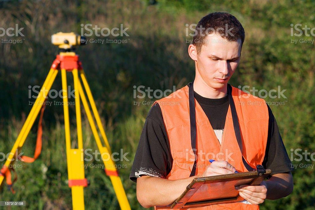 Land surveyor taking notes royalty-free stock photo