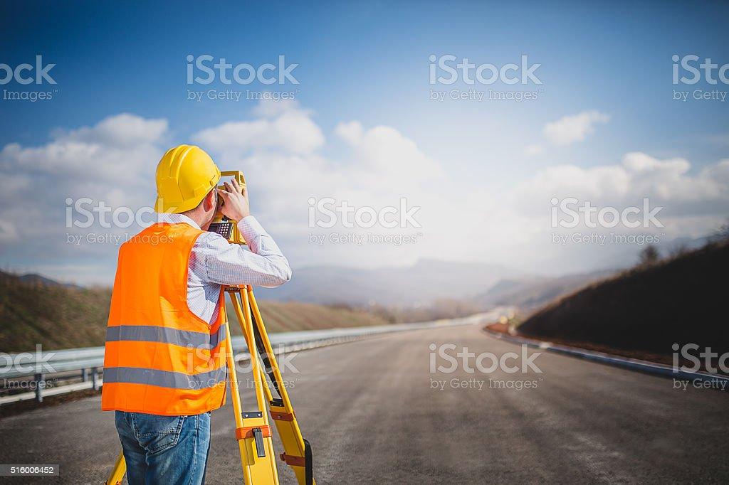 Land surveyor with total station stock photo