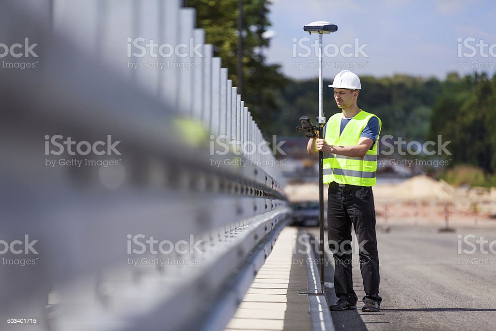 Land surveyor working with a GPS unit stock photo