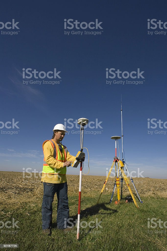 Land surveyor working with GPS stock photo