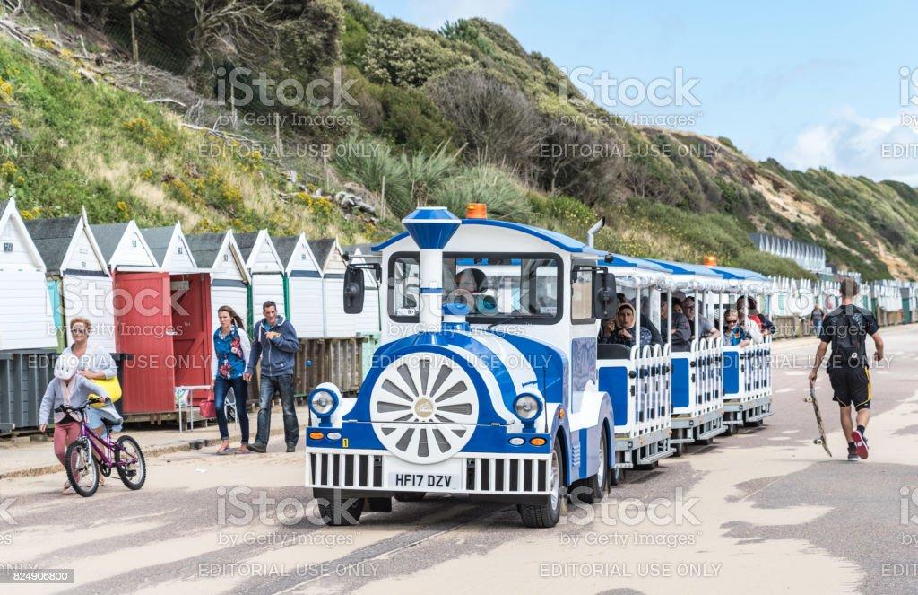 Land train with tourists on Bournemouth Beach stock photo