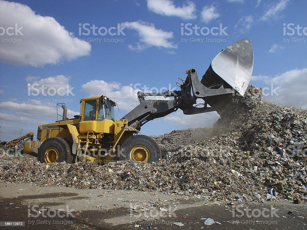 Landfill garbage waste dumped in the rubbish dump site royalty-free stock photo