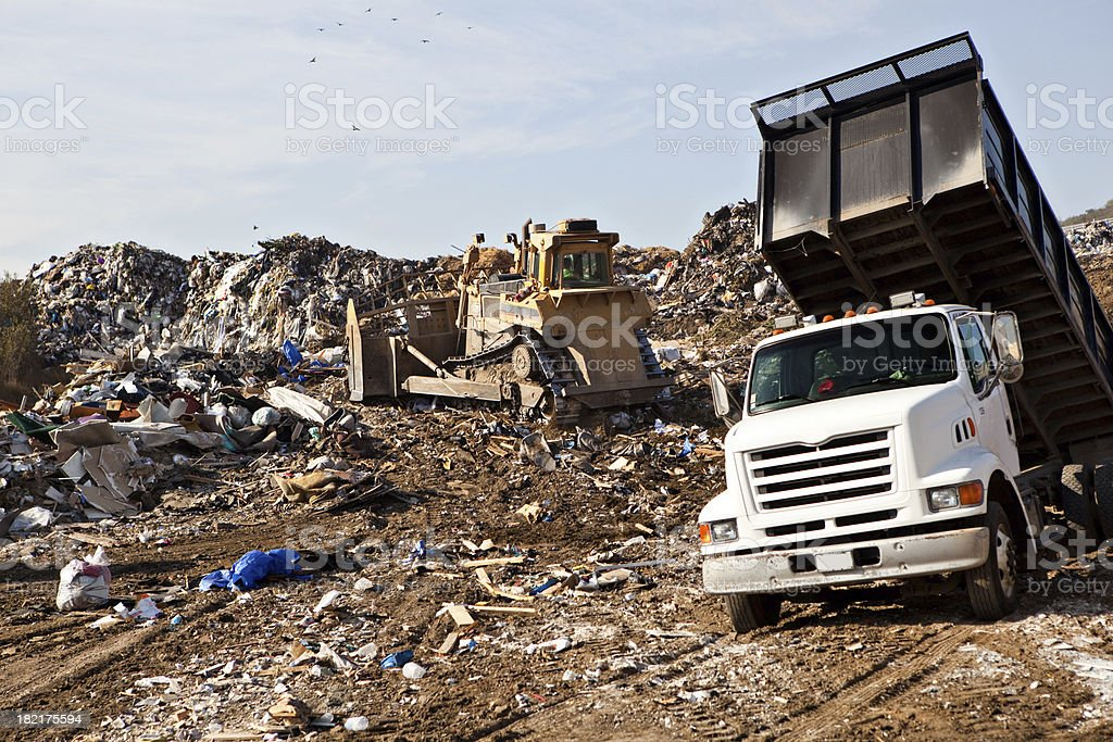 landfill with dump truck stock photo