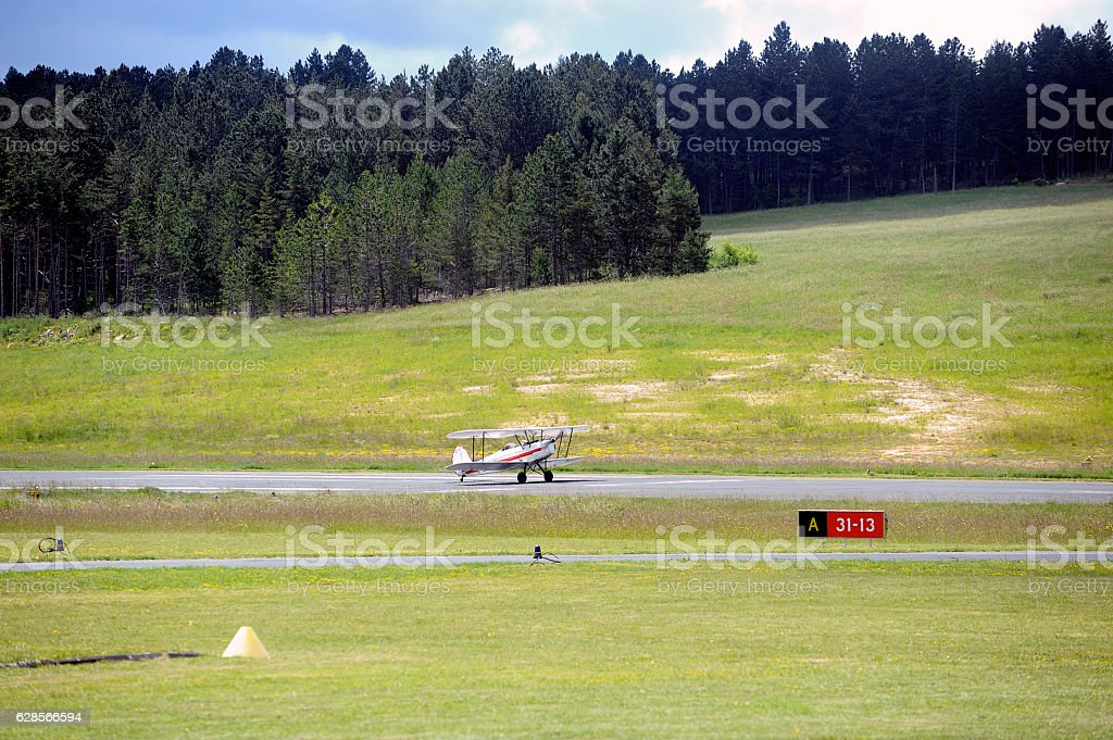 landing a biplane rolling on the Mende airfield stock photo