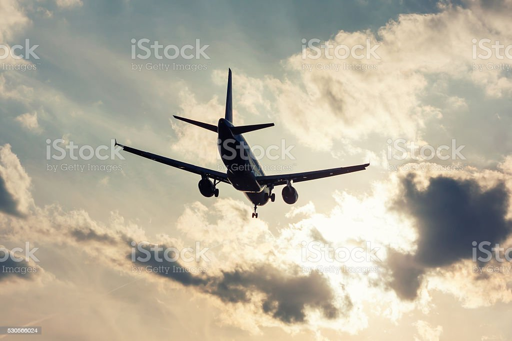 Landing aircraft in backlight royalty-free stock photo