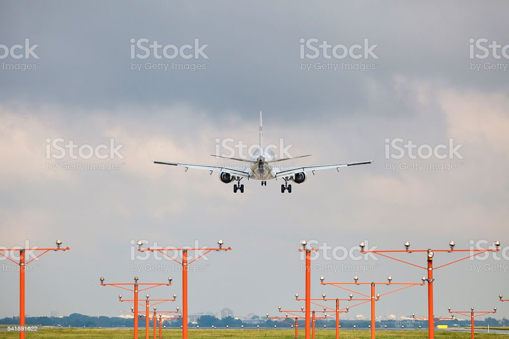Landing airliner stock photo