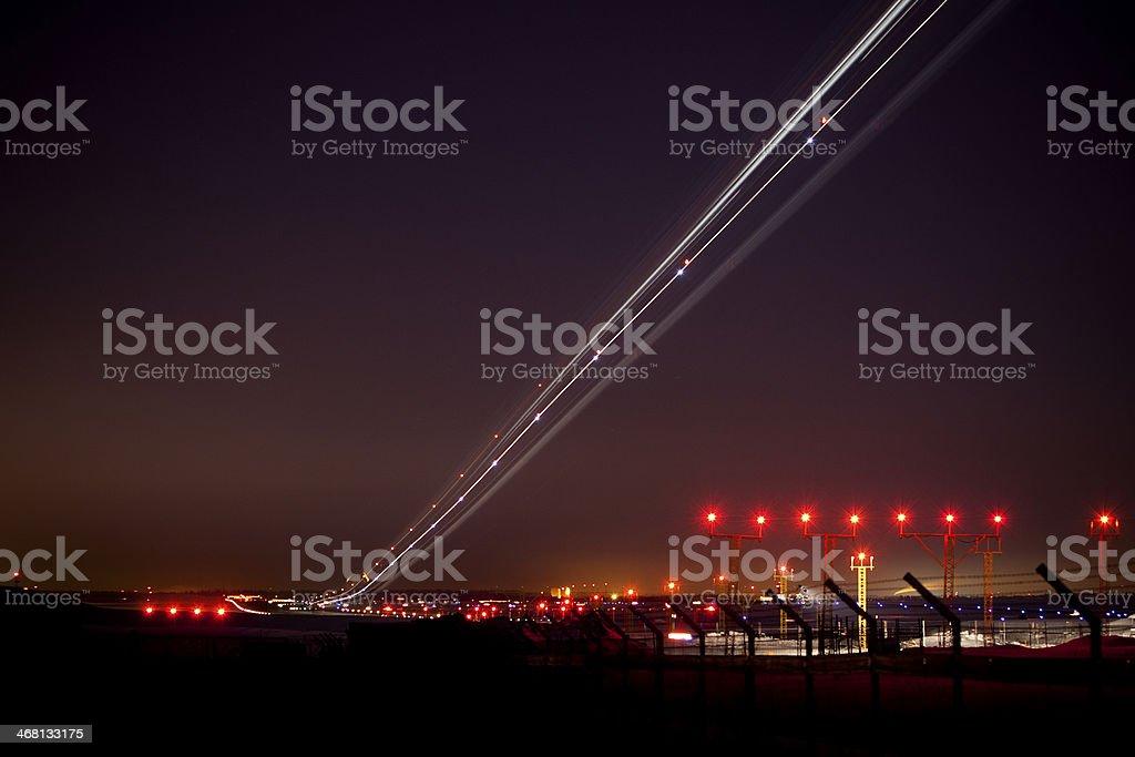 Landing airplane at night stock photo