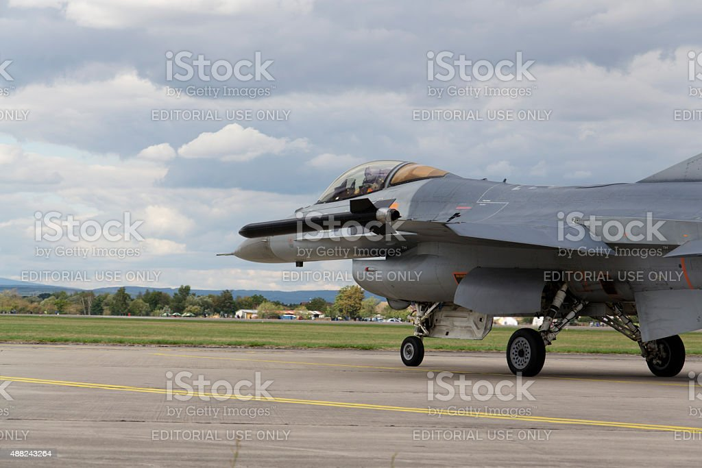 Landing F-16 Fighting Falcon with Belgian flag stock photo