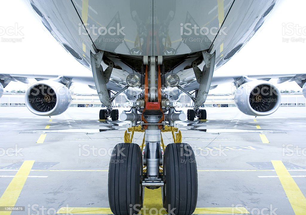Landing gear shown in use under airplane  stock photo