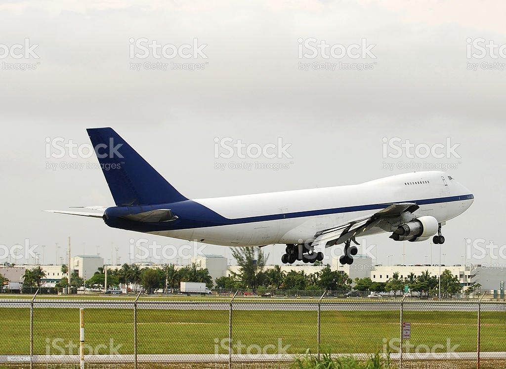 Landing heavy jumbo jet royalty-free stock photo