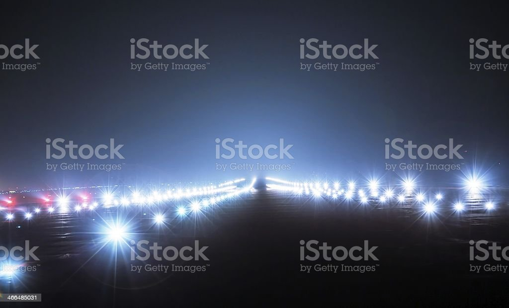 Landing lights at night stock photo