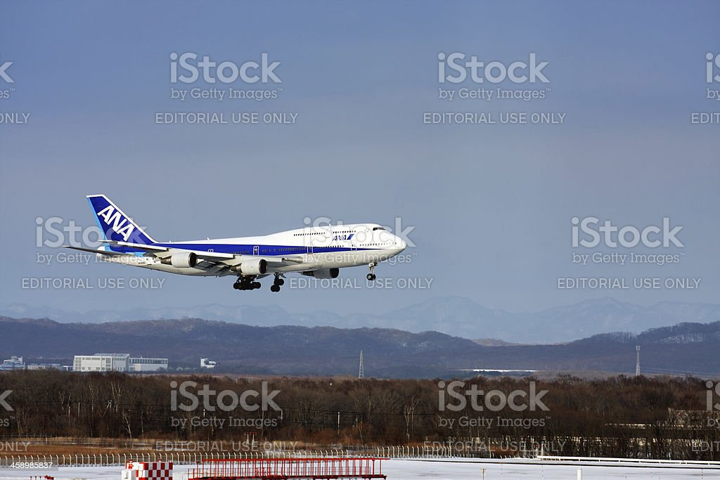 Landing of B747-400 ANA airplane at New Chitose Aairport Sapporo stock photo