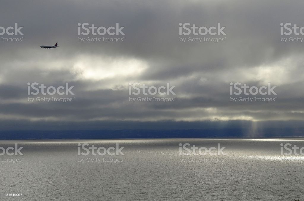 Landing plane over water stock photo