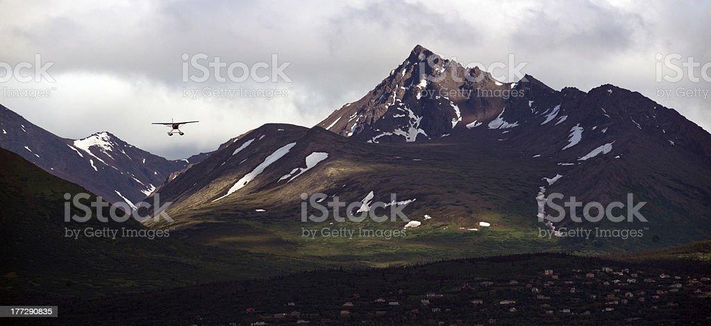 Landing Soon Bush Plane Flys in to Alaska Airport stock photo