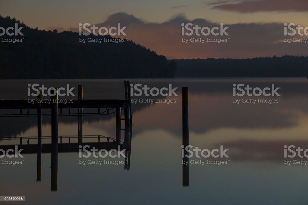 landing stage on the werbellinsee at dawn light stock photo