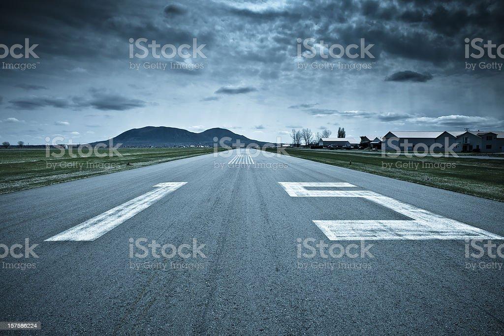 Landing strip, runway. Dramatic weather. stock photo