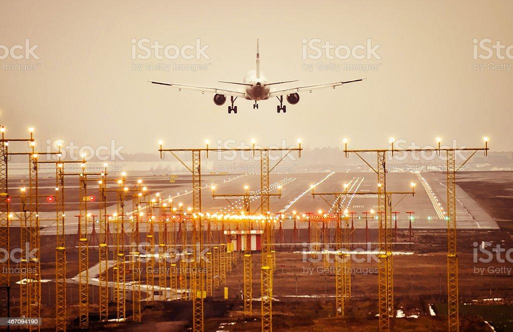 Landing to runway evening sunset stock photo