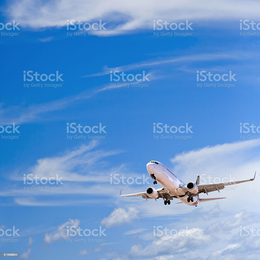 Landing twin-engine commercial airliner royalty-free stock photo