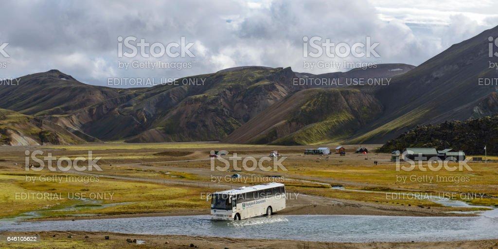 Landmannalaugar Bus Service crossing a river in Iceland stock photo