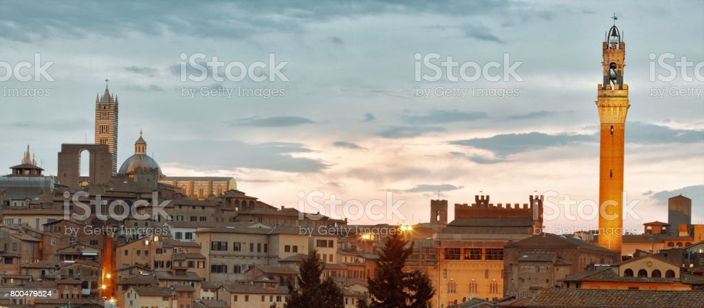 Landmarks of the medieval Siena  - Duomo and Torre del Mangia. Tuscany, Italy. stock photo