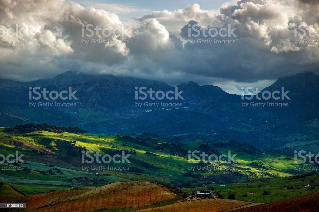 Landscape and cloudscape at sunset, Sierra de Grazalema, Andalusia, Spain stock photo