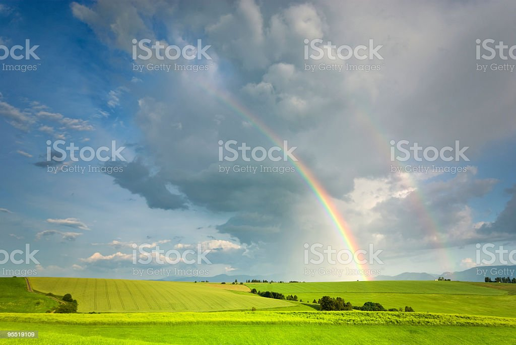 Landscape and  rainbow stock photo