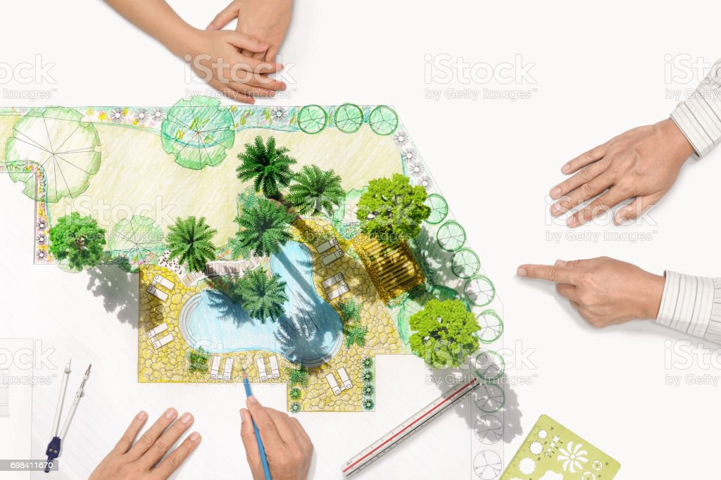 Landscape architect changing drawing at meeting with client stock photo