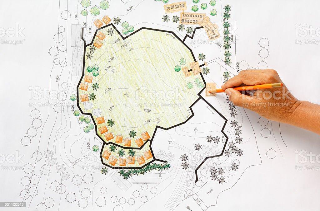 Landscape Architect Designing on site analysis plan for resort. stock photo