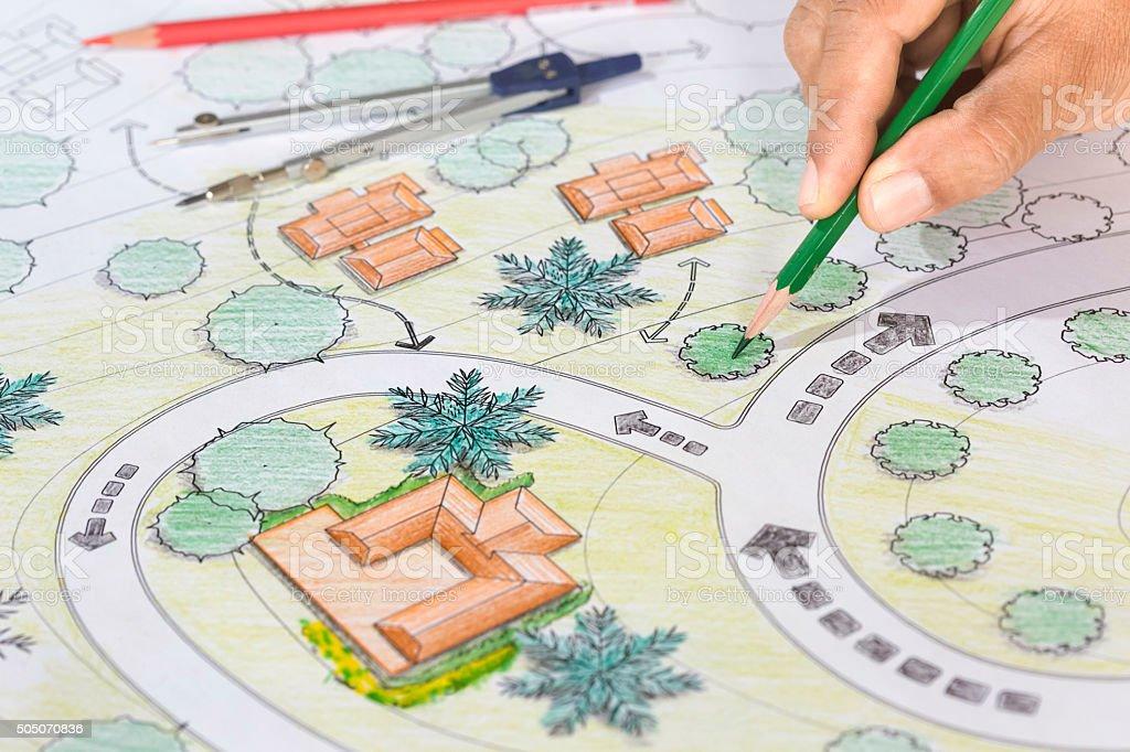 Landscape Architect Designs Blueprints For Resort. stock photo