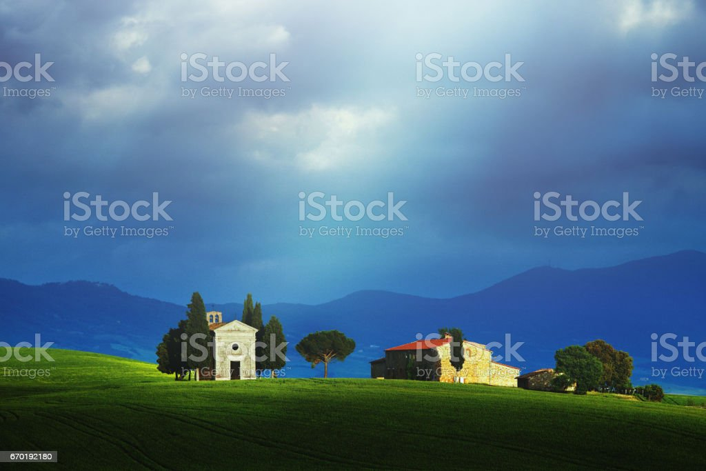 Landscape at sunrise in Tuscany (with the famous Cappella di Vitaleta) stock photo