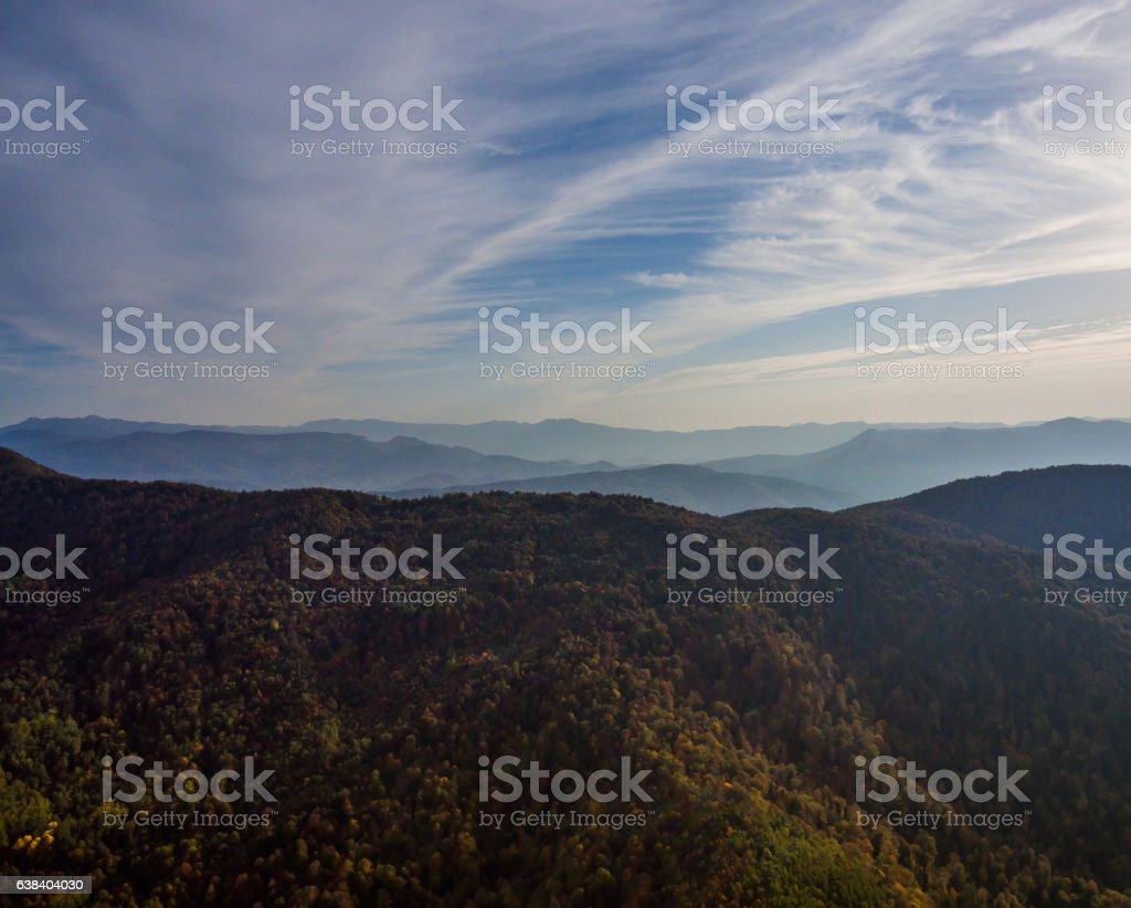 Landscape autumn mountain forest and overcast sky. stock photo