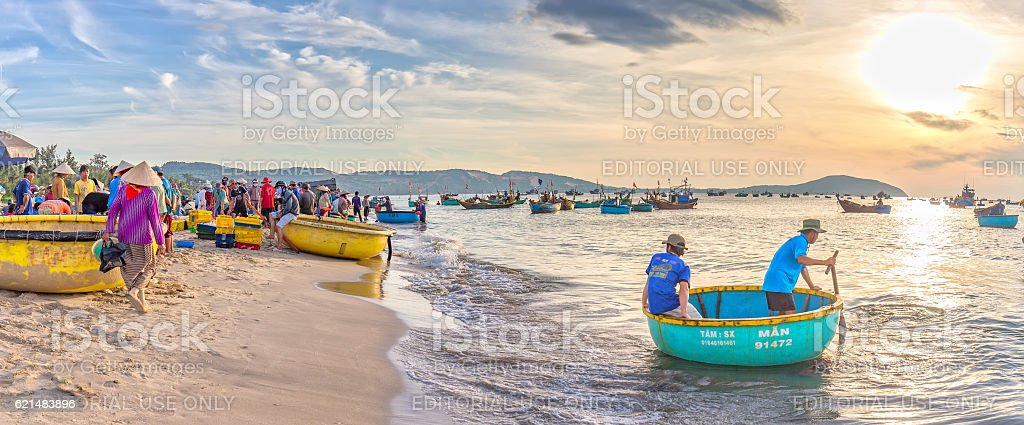 Landscape brisk trade in fish at Mui Ne fishing village stock photo