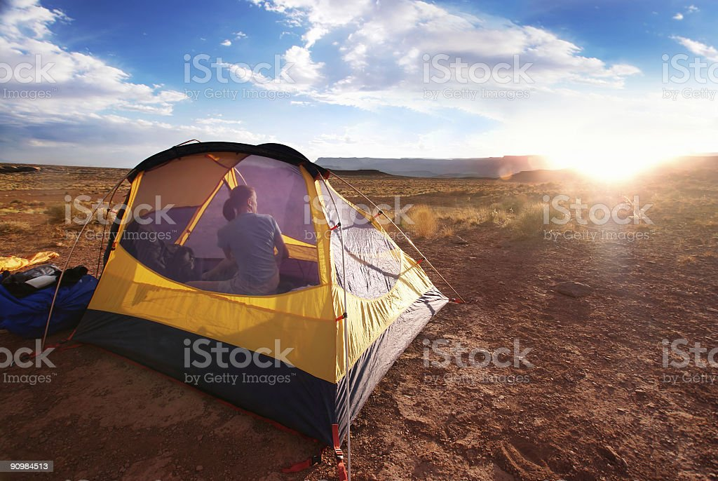 landscape camping sunset woman in tent royalty-free stock photo