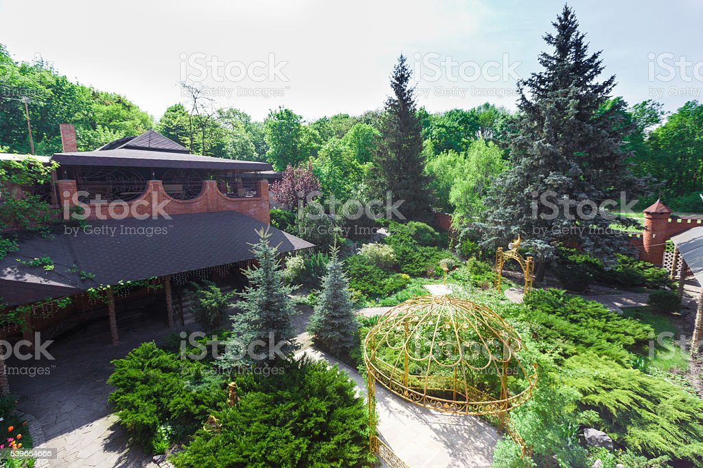 Landscape design, evergreen bushes and path stock photo
