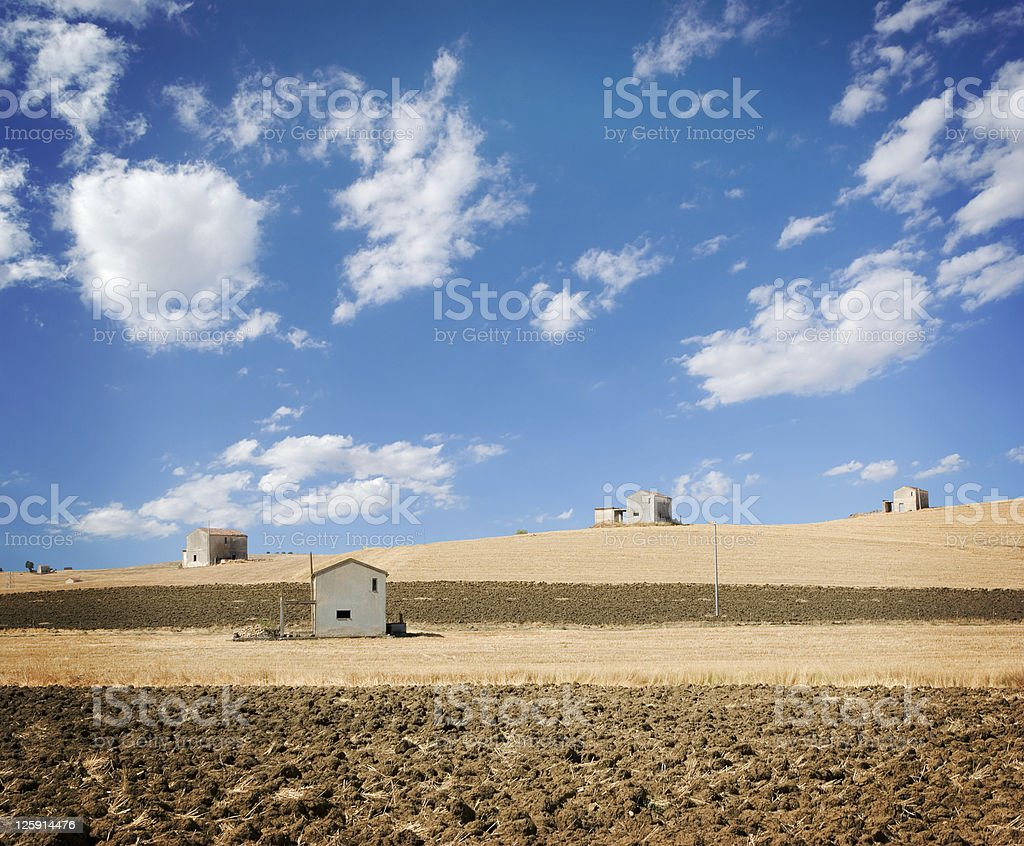 landscape for rural houses in fields and white clouds royalty-free stock photo