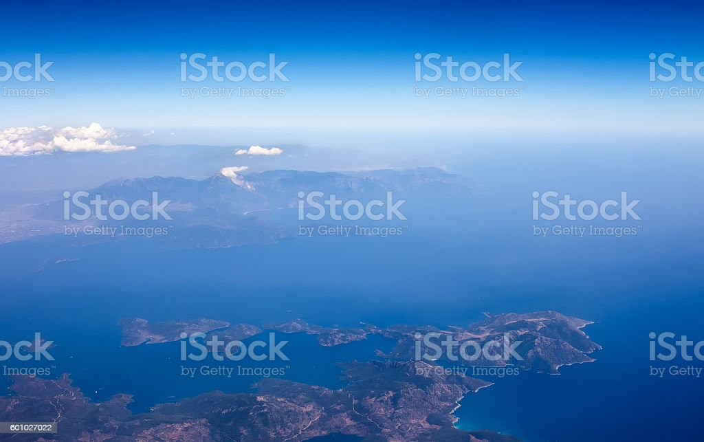 Landscape from plane window, show land, sea and clouds. stock photo