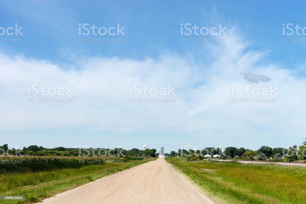 Landscape - Gravel Road Leading to Small North Dakota Town stock photo