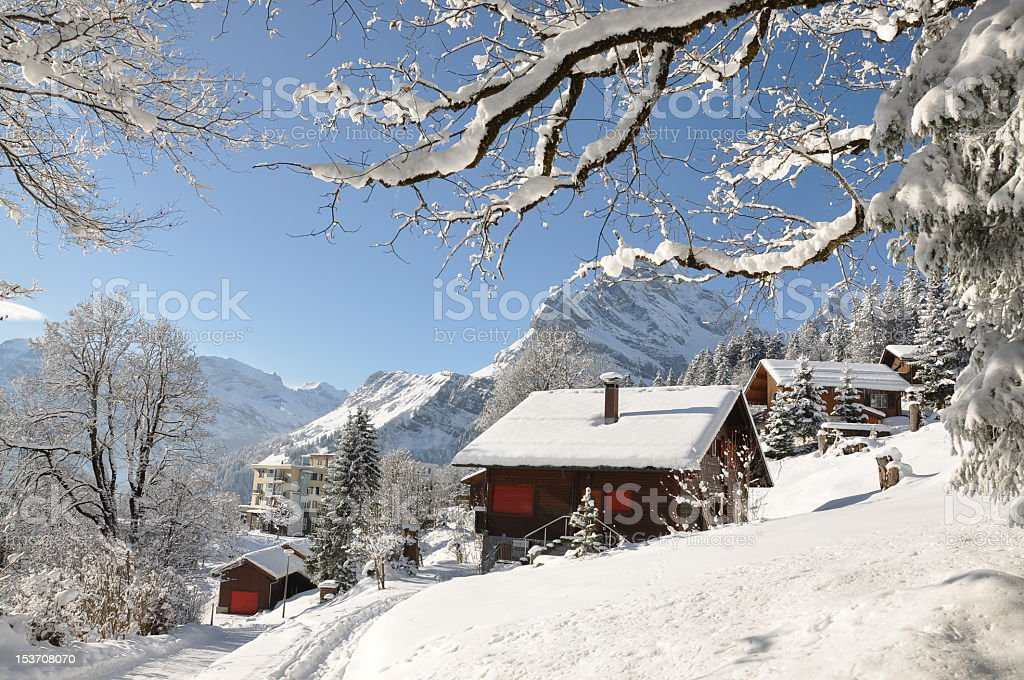 Landscape image of a snowy alpine hut stock photo